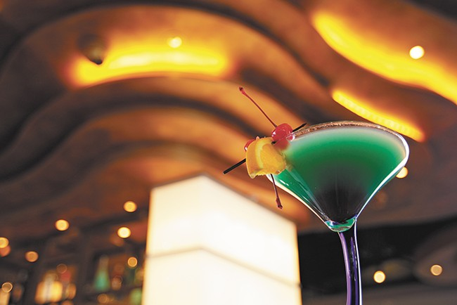 The Blue Lagoon Martini begs to be drank at Liquid. - YOUNG KWAK