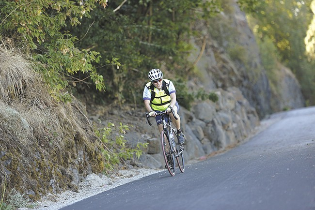 Cyclist Martha Jones glides over the freshly paved section of the Ben Burr Trail near South Altamont Street. - YOUNG KWAK