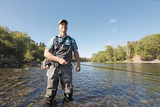 Spokane Riverkeeper Jerry White in the Spokane River near Peaceful Valley. - YOUNG KWAK