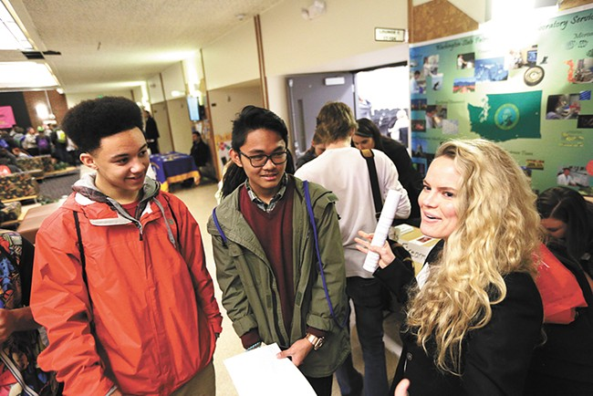 Elijah Mananis (center) and Brent Dishneau lob questions at Kate Sanburn, a Gonzaga law student, during the Youth and Justice Forum at Spokane Falls Community College. - YOUNG KWAK