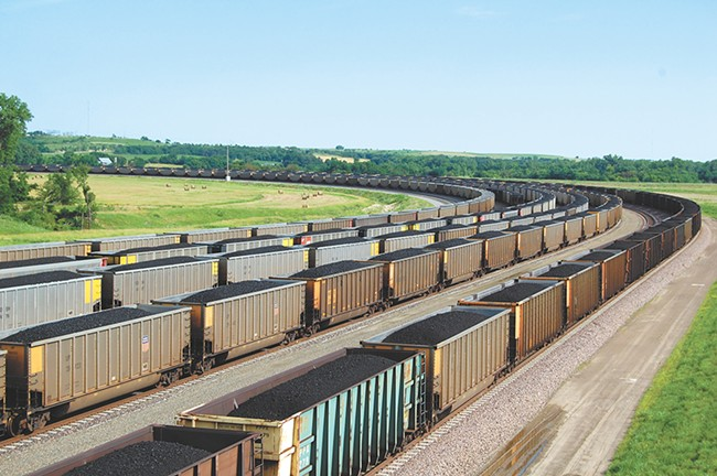 BNSF will study whether covering cars can keep coal and dust from blowing off trains.