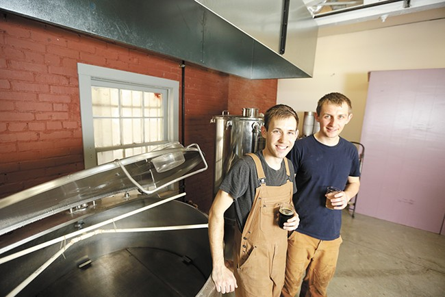 "Patrick Sawyer, left, and Jake Wilson are changing Chewelah's ""Kokanee mindset,"" one craft beer at a time. - YOUNG KWAK"