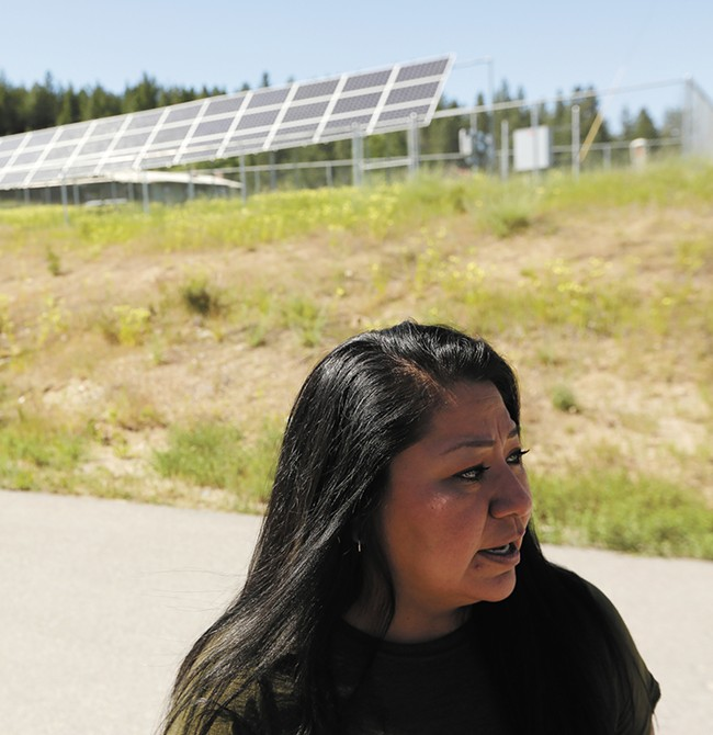 Maria Cullooyah, planning manager for the Spokane Tribe, is helping the tribe move toward renewable enery, like the community solar array behind her. - YOUNG KWAK