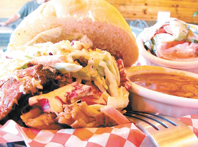 """Relic serves its meat """"naked"""" so diners can pick their favorite regional barbecue flavor. - CARRIE SCOZZARO"""
