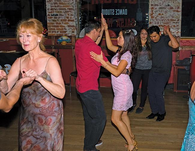 Dancers at Spokane's Satori Dance Studio move to Latin rhythms. - HECTOR AZION