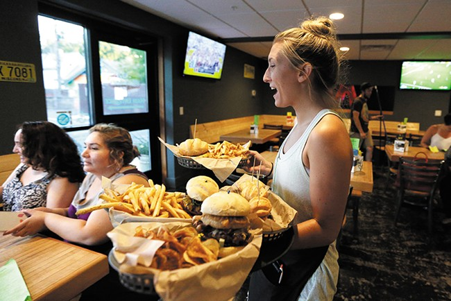 Brooke Whitsell brings out an order at Wisconsinburger. - YOUNG KWAK