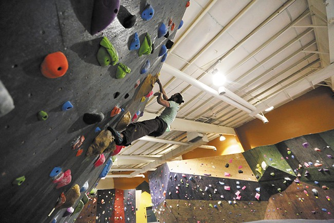 Co-owner Adam Healy climbs at Bloc Yard Bouldering Gym. - YOUNG KWAK