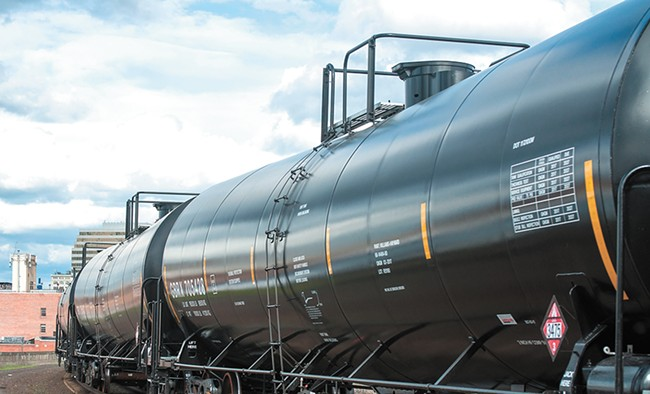 Oil trains roll through Spokane multiple times every day. - DANIEL WALTERS