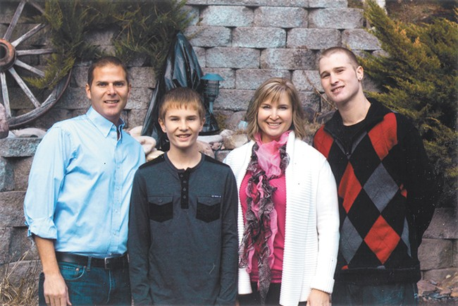 Tyler (right) with his mom, half brother and stepfather on Thanksgiving 2014.
