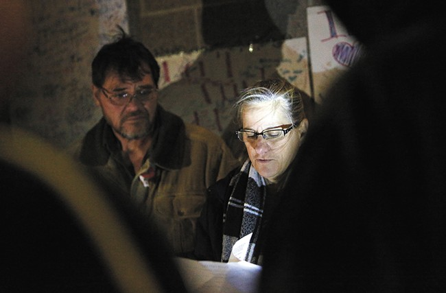 Donna Fagan, pictured in front of her husband, City Councilman Mike Fagan, organized a candlelight vigil on Sunday to pray for those who are lost to their circumstances. - YOUNG KWAK