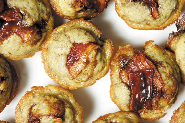 Not only is there bacon atop these mighty mini muffins, but that bacon is candied