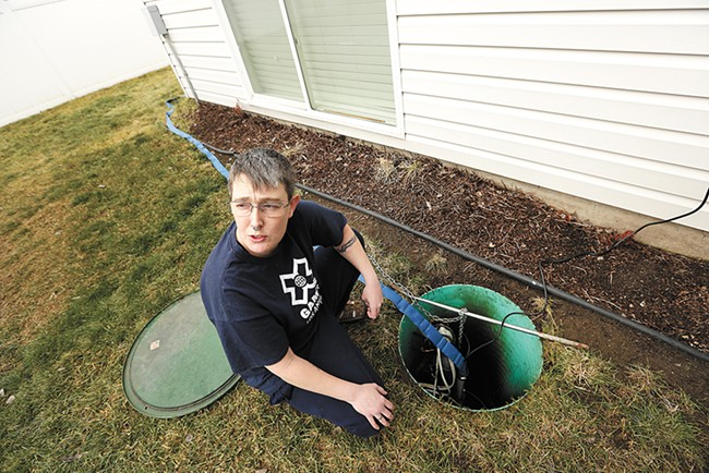 Terry Horne's sump pump wasn't enough to keep water out of her basement two times last year. - YOUNG KWAK