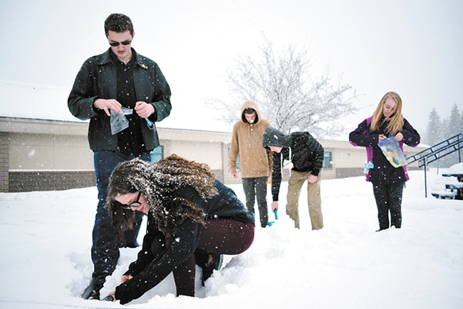 Students Trysta Mitchell and Max Cornell demonstrate how to measure snow density. - WILSON CRISCIONE