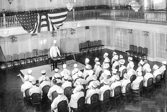 Chef Mathieu speaks to the Davenport's culinary team in this 1922 photo. - DAVENPORT HOTELS PHOTO