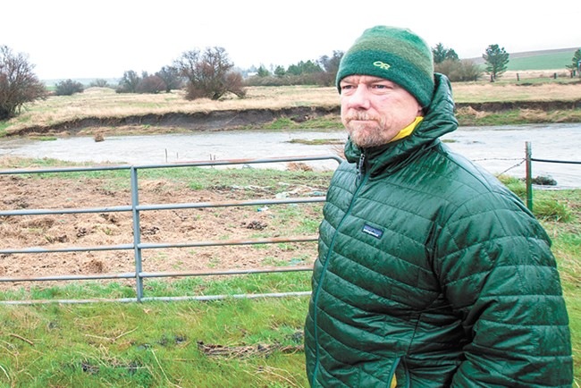 Spokane Riverkeeper Jerry White stands in front of a Hangman Creek property where horses have been allowed to illegally graze. - DANIEL WALTERS PHOTO