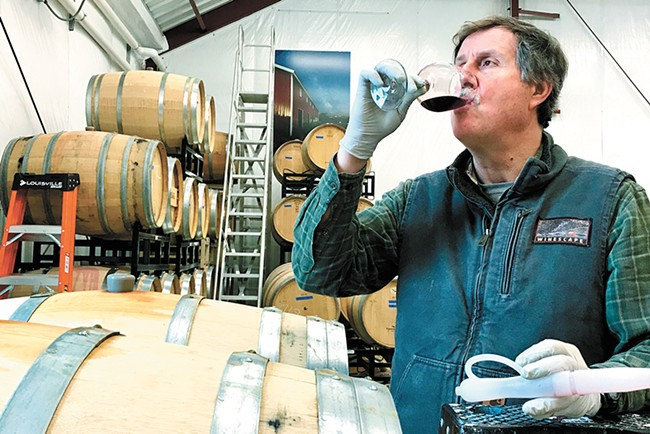 Phillip Butterfield tastes and tests Winescape's malbec barrels. - PATRICIA BUTTERFIELD PHOTO