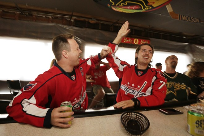 Greg Kvasov, left, and Tony Sizov celebrate a goal by the Washington Capitals during an NHL playoff game between the Capitals and the Tampa Bay Lightning, at the Hub Tavern.