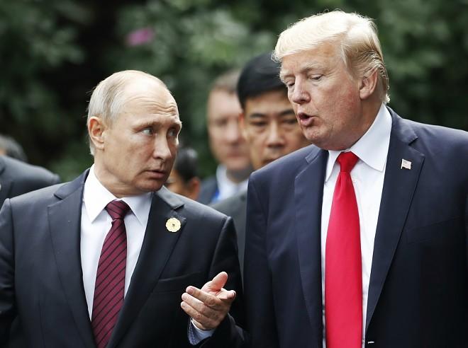 President Donald Trump and President Vladimir Putin of Russia, at the APEC summit took in November 2017. - JORGE SILVA/POOL VIA THE NEW YORK TIMES