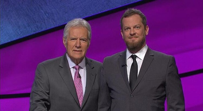 Jeopardy! host Alex Trebek and contestant Jon Brown