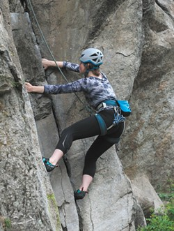 A climber near Minnehaha Park. - QUINN WELSCH