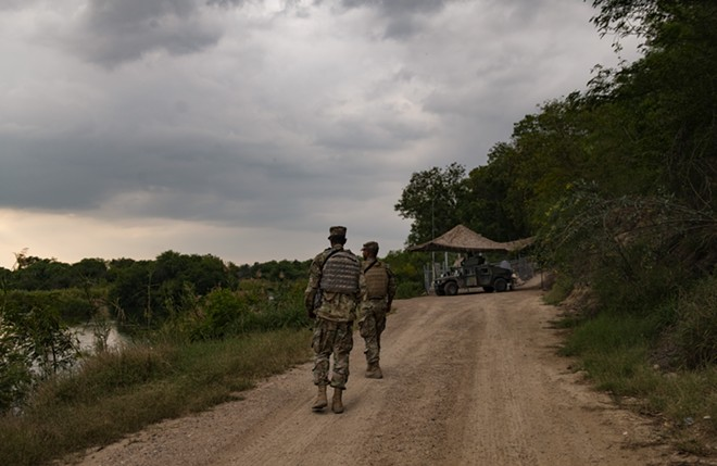 Members of the U.S. National Guard near the border with Mexico in south Texas, April 10, 2018. National Guard troops in four states will not deploy to the southern border, the states' governors announced the week of June 17, over mounting objections to the Trump administration's policy of separating children from their parents there. - LYNSEY ADDARIO/THE NEW YORK TIMES