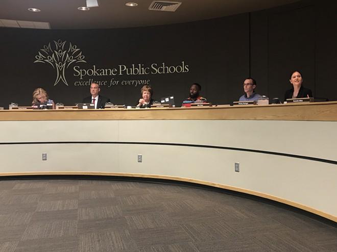 The Spokane Public Schools Board of Directors and superintendent Shelley Redinger (right). - WILSON CRISCIONE PHOTO