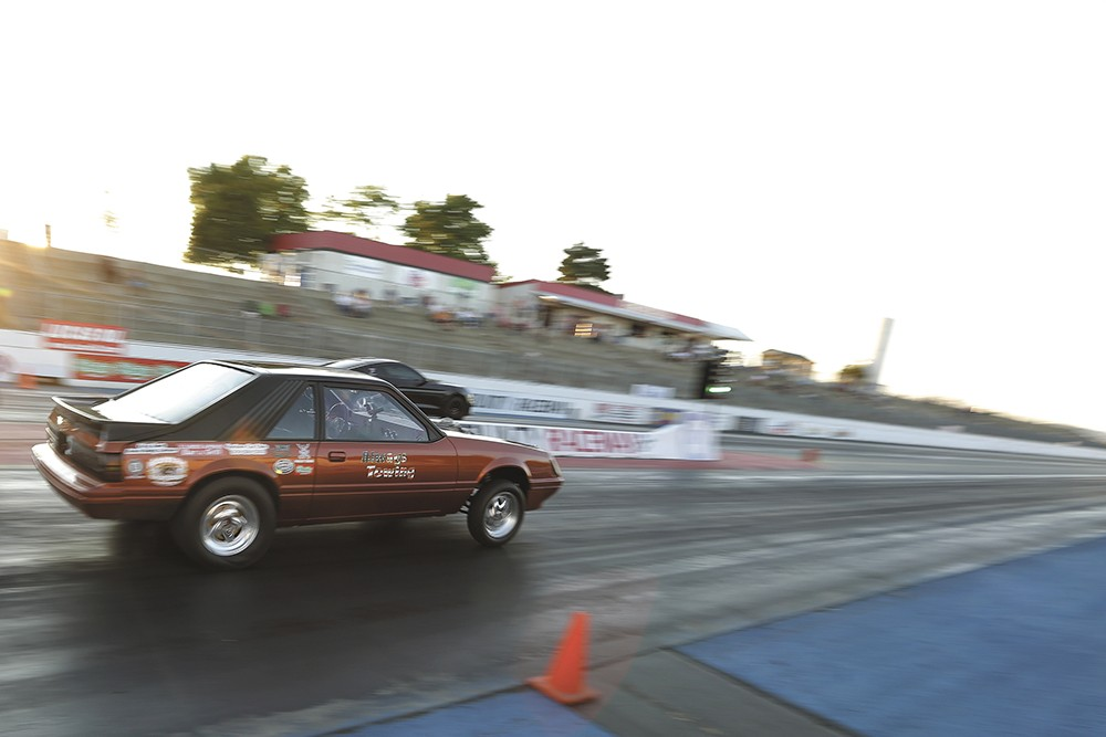 Rachelle Stephens guns  her 1984 Ford Mustang GT toward the finish line. - YOUNG KWAK
