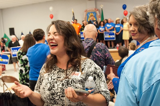 Madeline Brown, Jessa Lewis's campaign manager, laughs in glee about the initial results. - DANIEL WALTERS PHOTO