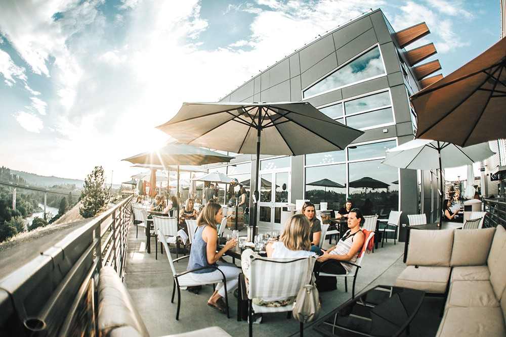 Maryhill's patio overlooking the Spokane River is a big summer draw. - ALICIA HAUFF PHOTO