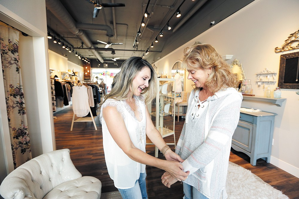 Boutique Bleu owner Amy Driscoll styles customer Laurie Smith-Boley. - YOUNG KWAK