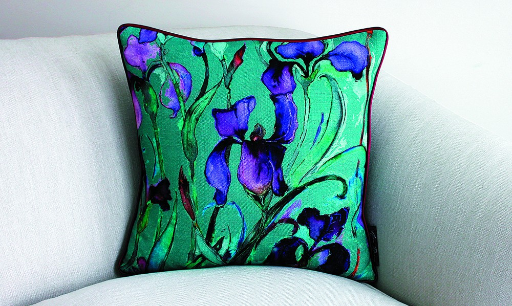 A colorful pillow made with Anna Benham's custom fabrics.
