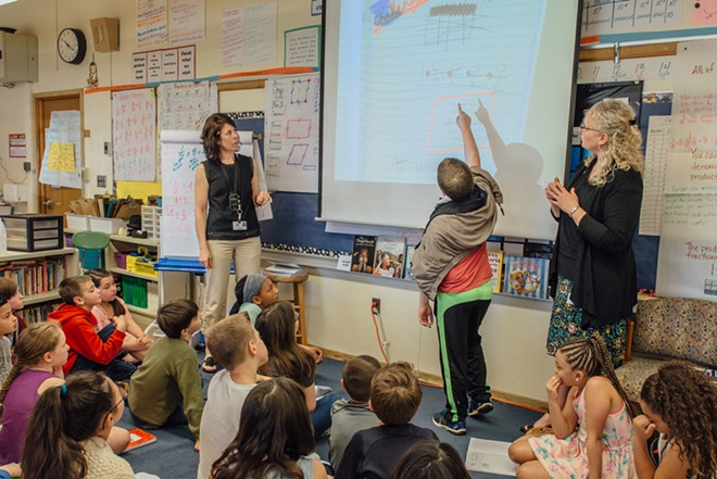 Franklin Elementary fourth- and fifth-grade teacher Beth O'Regan (left) during a math lesson.