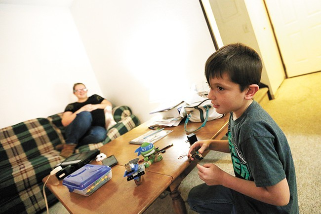 An initiative to house homeless families in Spokane helped Jordan, pictured here last year, find a home - YOUNG KWAK PHOTO