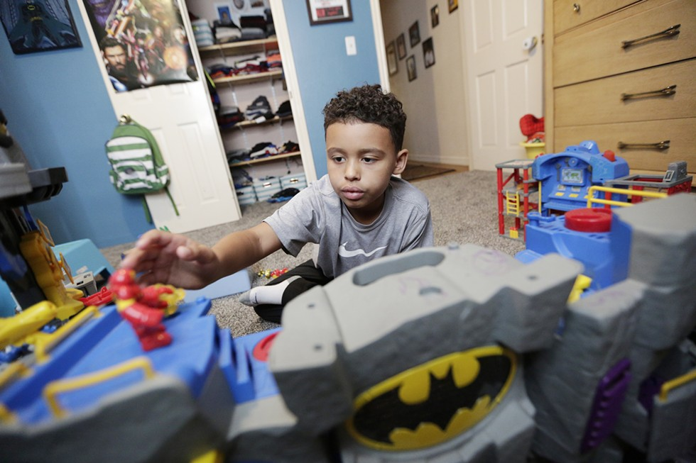 Isaiah Muse, 7, was adopted by relatives after losing his parents at age 4. - YOUNG KWAK