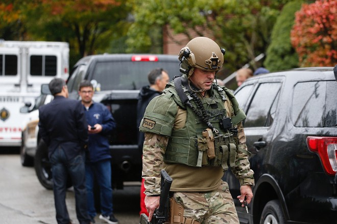 Law enforcement personnel at the scene of a mass shooting at the Tree of Life Synagogue in Pittsburgh, Oct. 27, 2018. Police reported that there were multiple casualties, and that a suspect was in custody. - JARED WICKERHAM/THE NEW YORK TIMES