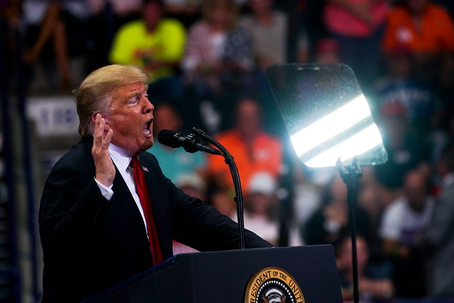 President Donald Trump speaks during a campaign rally in Estero, Fla., Oct. 31, 2018. As President Trump and his allies have waged a fear-based campaign to drive Republican voters to the polls, far-right communities have parsed his statements, looking for hints of their influence. - DOUG MILLS/THE NEW YORK TIMES