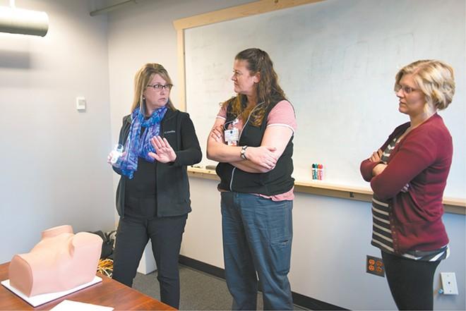 Kelly Anderson (left) trains Georgia Davenport (center) and Josilyn Twardoski how to do pelvic exams. - SAMANTHA WOHLFEIL