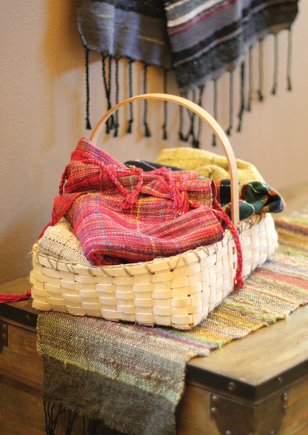 Sue Tye custom-dyes the fibers she weaves into tablerunners, throws and pillow covers - CARRIE SCOZZARO PHOTOS