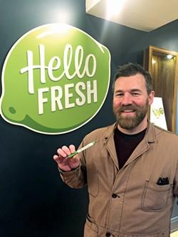 Matt Thompson, at HelloFresh HQ in New York City, with his new pen.
