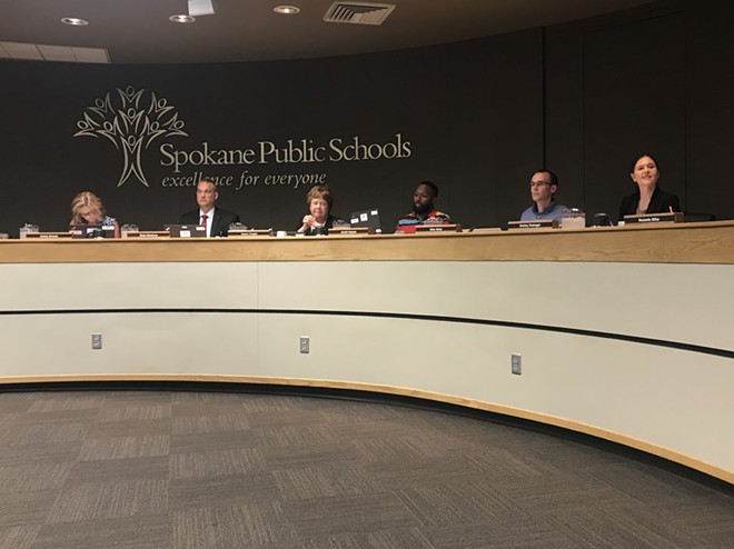 The Spokane Public Schools Board of Directors and superintendent Shelley Redinger (right). - WILSON CRISCIONE PHOTO