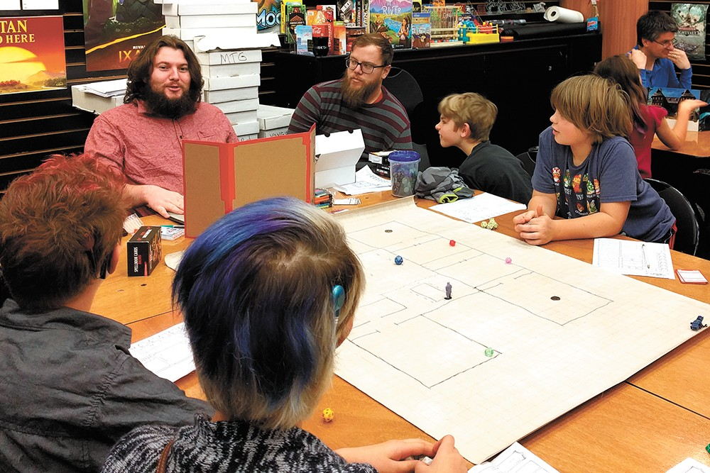 Irvin Reynolds, top left, leads weekly D&D sessions for kids at Uncle's Games. - CHEY SCOTT PHOTO