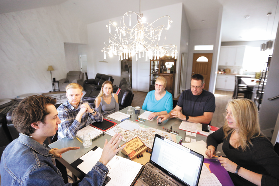 The Adrian family plays Dungeons & Dragons in their Spokane Valley home. - YOUNG KWAK