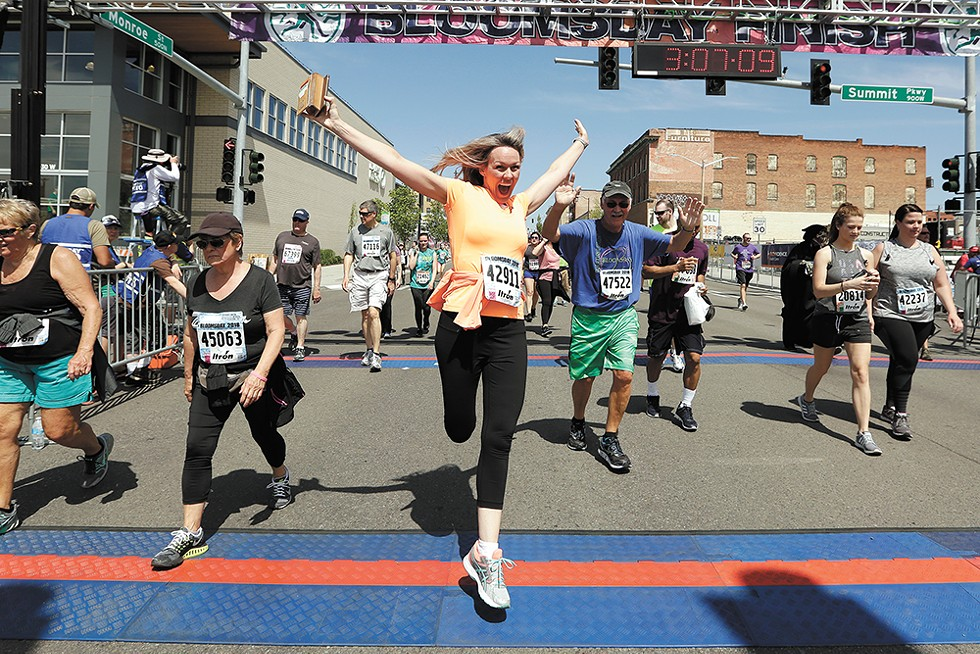 """THE FINISH LINE"" - One excited runner crosses the finish line during the Lilac Bloomsday Run on May 6."
