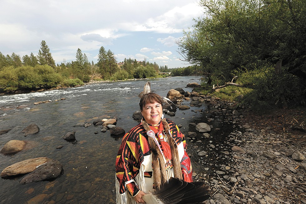 """WE LIVE IN WATER"" - Margo Hill, a Spokane Tribe judge, Eastern Washington University professor and contributor to Paul Lindholdt's book The Spokane River, poses for a photograph west of the Sandifur Bridge near the confluence of Latah Creek and the Spokane River."