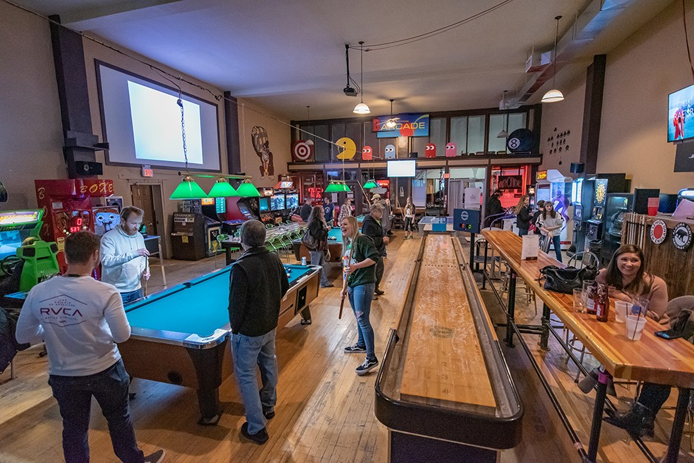The game room at the Roxie Spokane in Hillyard. - ERICK DOXEY PHOTO