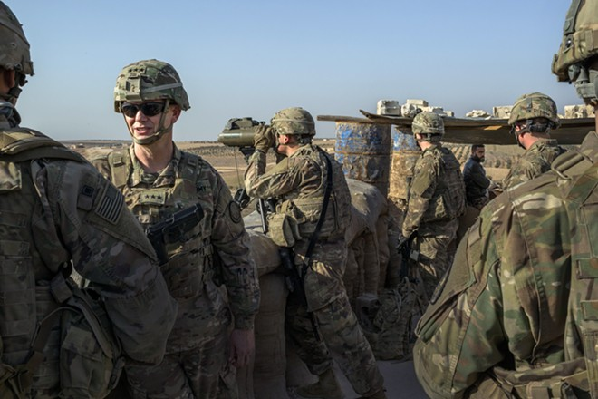 Lt. Gen. Paul Funk, second from left, with Special Forces troops near Manbij, Syria, on Feb. 7, 2018. The U.S. has started withdrawing its troops from Syria, an American military spokesman said on Friday, Jan. 11, 2019, further muddling the Trump administration's plans for disengagement from one of the Middle East's most complex battlefields. - MAURICIO LIMA/THE NEW YORK TIMES