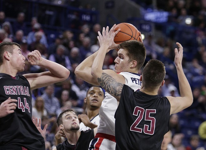 Gonzaga forward Filip Petrusev, center, grabs a rebound against Central Washington. - YOUNG KWAK