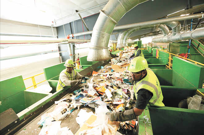 Six days a week, truckloads of plastic bottles, cardboard, glass and newspaper run along an intricate set of conveyor belts and bins to be sorted at Waste Management's Spokane Materials and Recycling Technology (SMaRT) Center. - YOUNG KWAK PHOTO