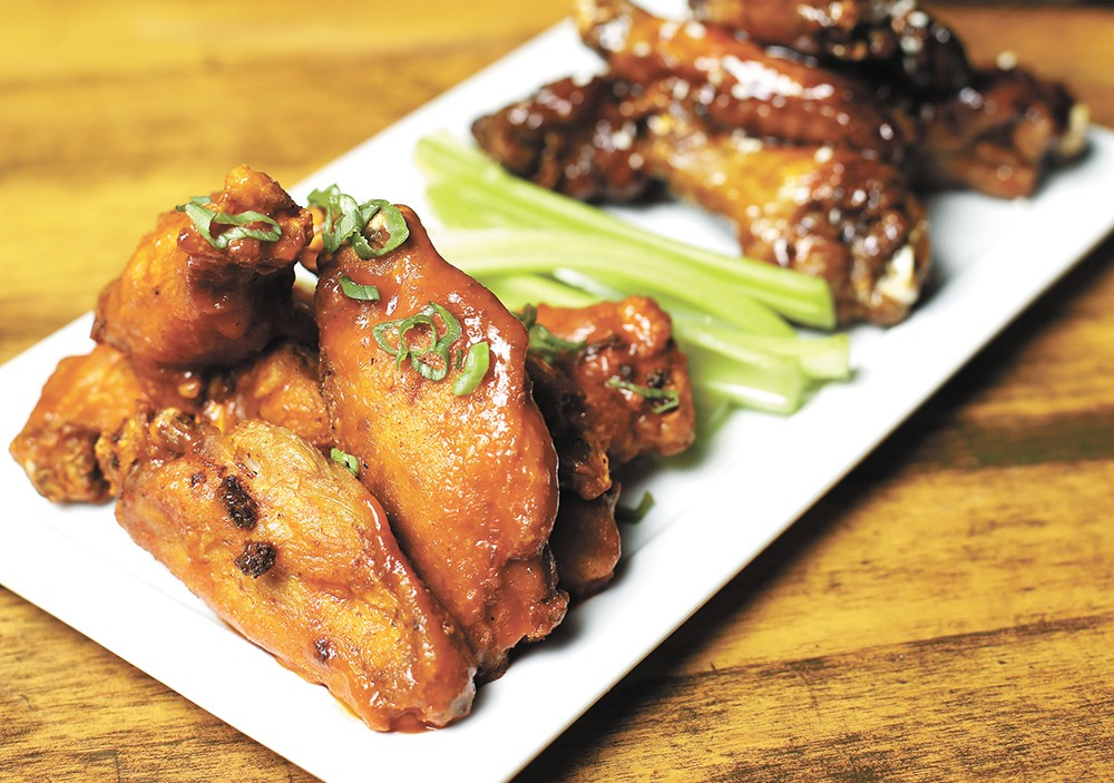 Wings can be coated in a range of tasty sauces at the Viking pub, which offers special pricing on Mondays. - YOUNG KWAK