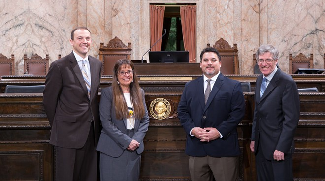 FROM LEFT: Washington state Rep. Marcus Riccelli and Spokane Tribe Chair Carol Evans, Spokane Tribe board member Tiger Peone and Rep. Timm Ormsby pose for a photo in Olympia. - PHOTO COURTESY OF MIKE TEDESCO